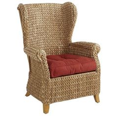 """In Portuguese, the word <i>graciosa</i> means """"graceful"""" or """"enchanting,"""" which we feel is a pretty apt description of our visually striking Graciosa Wing Chair. Hand-woven of seagrass and rattan to create a unique multitonal, braided effect, it's our fresh, graceful, enchanting interpretation of a classic silhouette."""