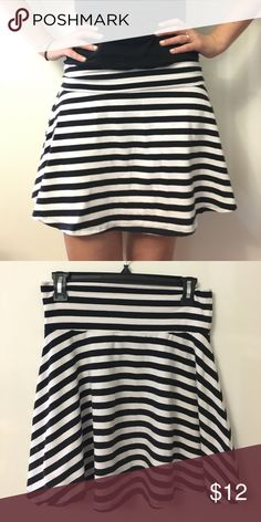 """🐼 Forever 21 Black and White Favorite Skirt 🐼 Forever 21 Favorite Skirt with adjustable waistband. Flaired mini skirt, perfect for summer.  🐼The Deets🐼 ❗️Size medium ❗️Solid Black and White  ❗️95% Cotton, 5% Spandex (stretchy!!) ❗️26"""" Waist ❗️18"""" Length  Reasonable offers accepted!! Check out my other listings for other Forever 21 items  to bundle! Let's make a deal 🤝 Forever 21 Skirts Mini"""