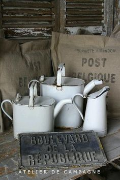 Vintage French enamelware pitcher and watering cans, brought to you by Atelier de Campagne.
