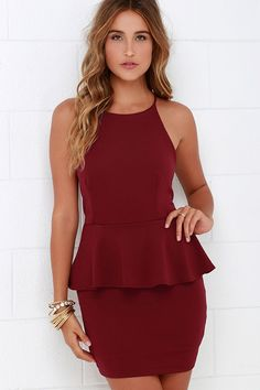 Slip into the Mischievous Maiden Burgundy Peplum Dress for a fierce and flirty debut! Lightly textured burgundy knit fabric with the perfect amount of stretch constructs a high, halter neckline atop a sleeveless bodice with darting. A sultry, oversized keyhole (with top button) adds back appeal above a fitted tube skirt, while a playful peplum accentuates the waistline. Hidden back zipper. Fully lined. Self: 95% Polyester, 5% Spandex. Lining: 100% Polyester. Hand Wash Cold.