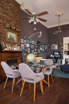 Name: Kerry Maloney Location: French Quarter — New Orleans, Louisiana Size: 800 square feet Years lived in: 6 years; Rented Six rows of neatly displayed wigs decorate a brick wall in Kerry Maloney's French Quarter apartment. They've been collected from Mardi Gras costumes throughout the years. They're decked out with stars and plumes, birds and elaborate handmade crowns. There's the French aristocrat, the drum major, the conehead, and the wizard. Like the dozens of framed snapshots that…