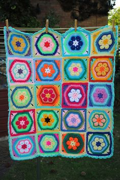 Hanging on the line | Flickr - Photo Sharing!  African flower granny square afghan.  (No pattern.)