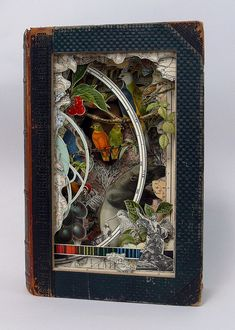 Alexander Korzer-Robinson's Book art. Made from old books and encyclopedias. All images in the final work are seen from their original place in the book.
