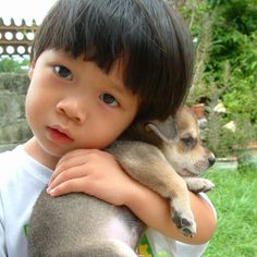 i don't know who's cuter: my nephew or the puppy :) gotta love them both hehe (taken two or three years ago)