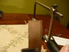 Cutting close to the pencil lines with a jeweler's saw.