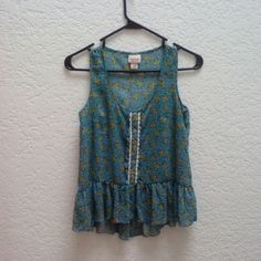 Mossimo Supply Co Blue Yellow Floral Peplum Tank Mossimo Supply Co brand from Target, size x-small. Runs slighty bigger so will fit a size small too. Sheer blue with yellow floral pattern. Peplum waist and buttons and lace down the front make this super girly and adorable. In like-new condition! Please ask any and all questions before purchasing. Thanks! Mossimo Supply Co Tops Tank Tops