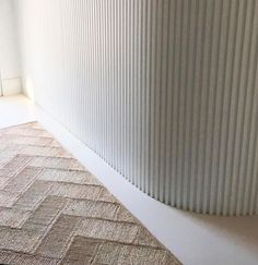 The Designory: herringbone jute rug from the Dharma Door photographed in the Ayana House, Sydney