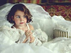 Such a cute idea to do a photo shoot with your daughter playing dress up in your wedding dress.