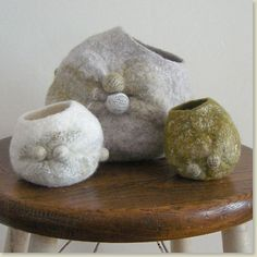 At first, I thought they were cat faces which would be really cool. Felt vessels by Suzanne Towns.