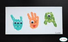This Funky Handprint Monsters canvas is a super fun Halloween painting idea that your kids will love!   AllFreeKidsCrafts.com