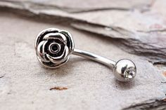 """Silver rose daith piercing, rook earring or eyebrow ring. The silver rose barbell is 16 gauge and 5/16"""" long curved barbell. The rose daith or rook piercing is solid surgical steel. All orders will ar"""