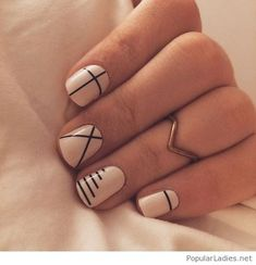 Black and white manicure with golden rings