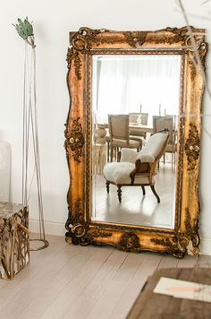 Golden, antique mirrors in a modern home