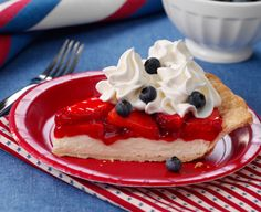 This refreshing dessert shows it's true colors with a cream cheese filling topped with a strawberry reduction and fresh blueberries.