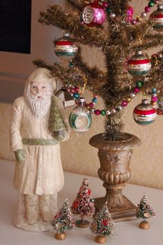 Vintage garland on tree, made from glass. Have some just like this and ornaments from my mom.