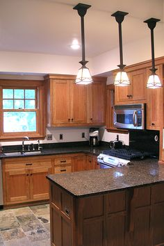 Cherry Kitchen Cabinets With Gray Wall And Quartz Countertops Ideas - Kitchen counter light fixtures