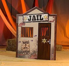 The Old West Jail Standee has the look and feel of an old western jail from the bars on the windows and wooden door to the brink showing through the stucco.