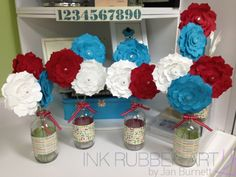 Really loving the paper-flowers-in-a-repurposed-glass-bottle trend!