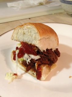You know your Southern when you've got a deer hunter in the family. My recipe for Slow Cooker Venison BBQ Sandwiches topped with creamy cider slaw #crockpot #venison #slowcooker