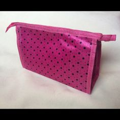 """PINK COSMETIC BAG New; never used; pink satin-like cosmetic case; black stars/dots; 8.5"""" long; top zipper closure Bags Cosmetic Bags & Cases"""