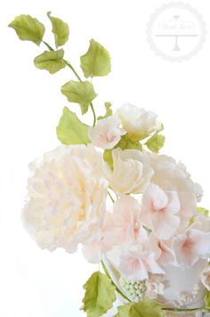 Peonies, tiny roses, hydrangea blossoms and leaves all in sugar