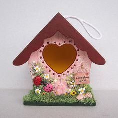 The perfect decoration for Spring. This little birdhouse is 3 1/2 tall, 3 1/2 wide and 2 1/4 deep. There is a pair of Lady Bugs in the front