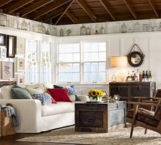 $899 Conway Trunk | Pottery Barn  Also loving the glass bottles along the perimeter of the upper walls. Looks nice but a hassle to clean.