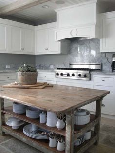 Farm house table repurposed with shelves added for an open island.
