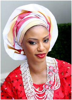 Bold striped gele, Shocking Red Lace and beads to die for....An incredible look for any bride