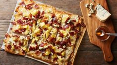 Blue Hawaiian Pizza- This fun riff on classic Hawaiian pizza trades bacon for Canadian bacon and adds blue cheese for an elevated take on an American favorite.