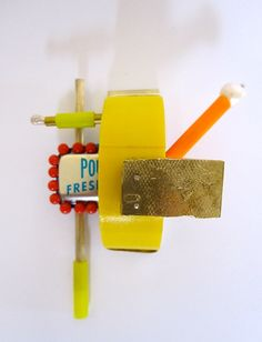 Clementine Edwards Pendant: Yellow gaffa, 2014 Silver, copper, brass, bronze, pearl, map pins, gaffa tape, paper clay, found objects