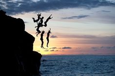 cliff jumping with my best friends in a tropical place