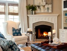 I like the cozy feel of this living room. Neutral with pops of color in the accessories. By Caroline Burke Designs & Associates