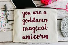 You Are A Goddamn Magical Unicorn Natural Cotton by elsieandnell