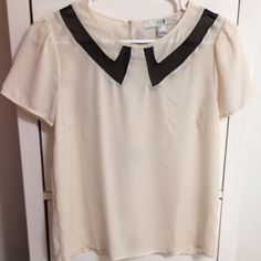 Cream top Adorable little top that can be dressed up or worn casually.  Cream color with black collar design at top.  Button closure at back of neck.  Worn once - in excellent condition Forever 21 Tops Blouses