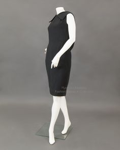 Black linen drop-waist dress with collar and deep V-back. Hem is weighted with chain, c.1966-70. Label: GIVENCHY PARIS, Made in France. FRC1997.04.026