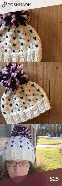 Cozy Heart Beanie with Pom-Pom Cute & cozy handknit beanie with black and pink hearts and a matching pom-pom! Fits a larger woman's head. 80% acrylic, 20% wool. Handmade Accessories Hats