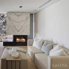 Bookmatched marble fireplace surround