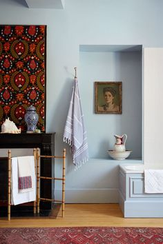 """[i]The main bathroom is painted in a pale blue from Papers & Paints. An alcove houses a Victorian bathing jug and an antique oil painting.[/i] Like this? Then you'll love [link url=""""http://www.houseandgarden.co.uk/interiors/bathroom""""]Bathing beauties: bathroom ideas[/link]"""
