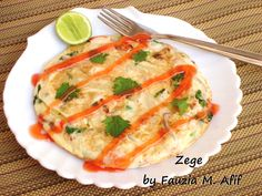 This excellent pizza-like omelette is aspecialityfrom Tanzania. Itmakes for an excellent quick-fix meal for brunch or a light lunch/dinner. Made with eggs, fries and any additional ingredients like leftover chunks of cooked chicken, chopped cooked sausages, cheese,chillies, onions etc, this is one very versatile recipe!
