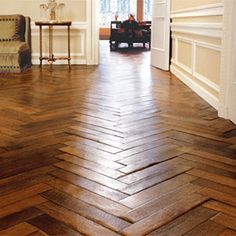 Herringbone/Chevron wood floor. Beautiful!