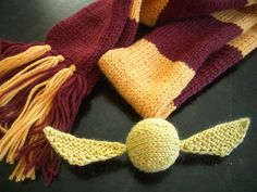 Golden Snitch free knitting pattern for Harry Potter fans Harry Potter Scarf & Golden Snitch by katbaro, via Flickr