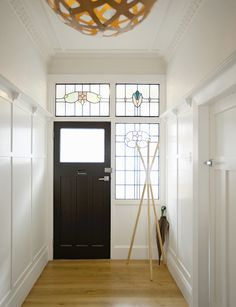 In this generously proportioned entryway, period features such as leadlight windows, ornate cornices and wooden panelling have been masterfully restored to preserve the original character of this three-bedroom bungalow. Photography by: Emma MacDonald. Leadlight Windows, Wooden Panelling, Entrance Ideas, Character Home, Inside Home, Colour Pallette, Cornice, Auckland, Hallways