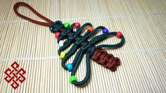 Paracord Christmas Tree Ornament Tutorial Here's my take on how to tie a paracord Christmas Tree ornament. This is definitely a must try for the paracord ent...