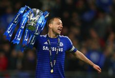 Captain John Terry of Chelsea celebrates with the trophy during the Capital One Cup Final match between Chelsea and Tottenham Hotspur at Wembley Stadium on March 1, 2015 in London, England.