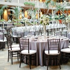 Color palette of gray, winter white and mint green centerpieces.   International Market Square Reception Space