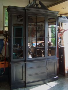 Just finished this awesome 2 piece antique china cabinet~painted black & distressed