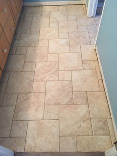 Installed Porcelain Tile In A Versailles Pattern Clients Bathroom