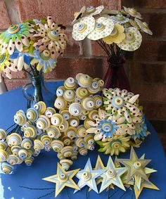 Baby button bouquet centerpieces for a baby shower, by rbkcreations on Flickr - love the stacked buttons #buttons #centerpiece #babyshower