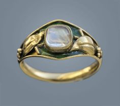 An Arts and Crafts gold, enamel and moonstone ring, British, circa Jewelry For Her, Old Jewelry, Antique Jewelry, Vintage Jewelry, Art Nouveau Ring, Edwardian Jewelry, Jewellery Sketches, Vintage Diamond, Antique Rings